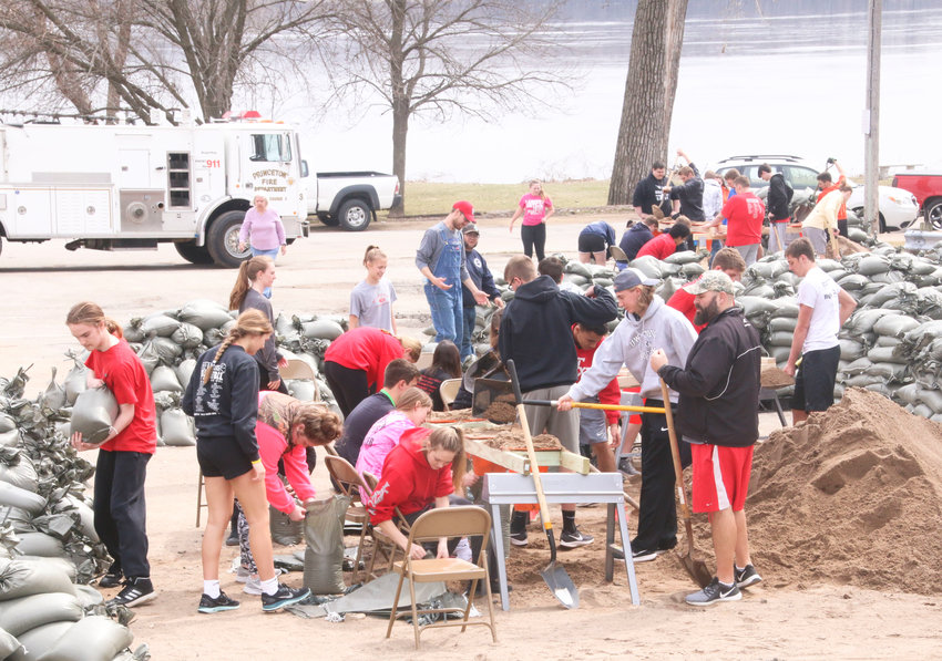 With the Mississippi River creeping over its banks, and major flooding predicted, North Scott High School students came to the aid of Princeton residents last week, spending two full days filling sandbags.