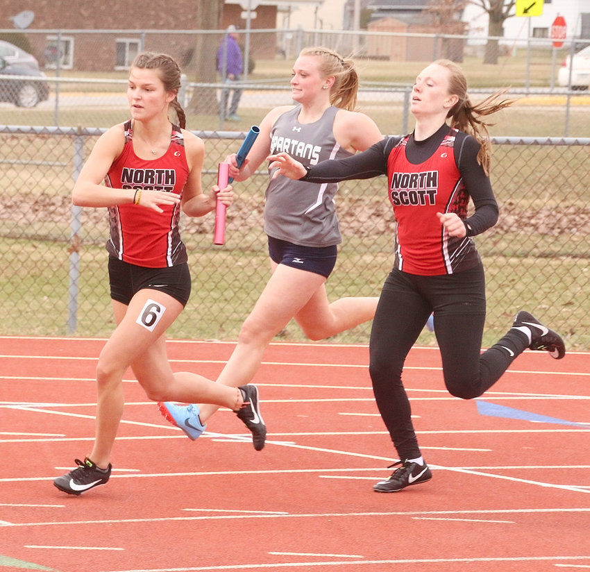 Seniors Sydney Fuller (l) and Brooke Corson ran the final two legs of the sprint medley relay and powered the Lancers to a fourth-place finish at Thursday's Lancer Invitational.