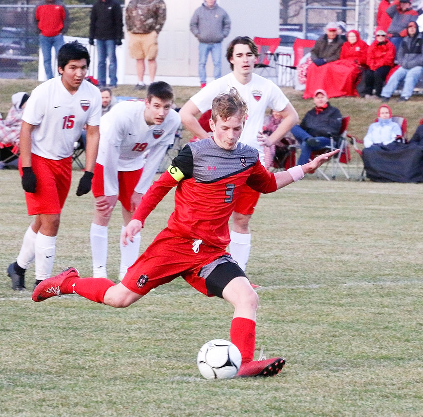 As a trio of Falcons look on helplessly, Lancer sophomore Chase Porter delivers what proved to be a back-of-the-net penalty kick.