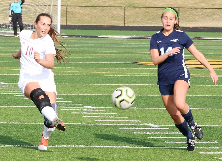 Continuing her hot-footed week, Lancer senior Rylie Rucker connected on this outside shot that knotted the score at 2-2 against Downers Grove South.