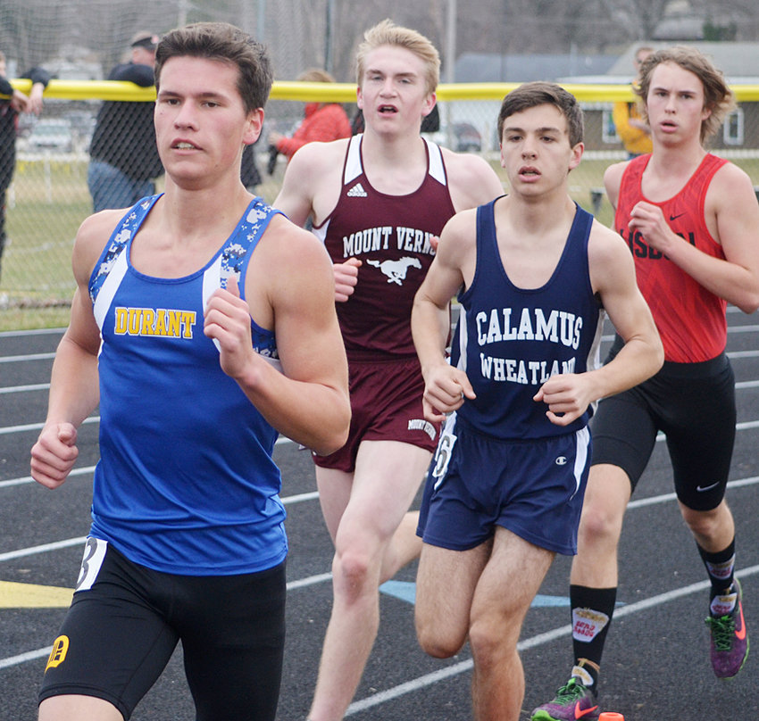 Easton Botkins (right) ran to the 1600-meter title in Wilton April 8.