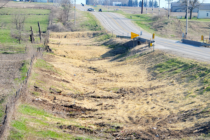 "Motorists coming to and from Wilton have noticed the removal of several trees around Mud Creek on Highway 38 south of Wilton. They were taken out on the east side of the highway near Dale and Mary Maurer's property. The Advocate News received the following message from the Iowa Department of Transportation: ""The adjoining property owner asked us to clear the brush and trees to restore the roadside to its original condition at the time the road was built. We agreed to do so because of the following issues caused by the dead and overgrown vegetation. 1. Trees were falling on a neighboring fence and causing livestock to get loose, creating a safety hazard on the roadway; 2. The dead fall from the trees and brush was creating a lot of extra maintenance work for us to clean up the debris; 3. The drainage was affected by this growth and causing some erosion problems that will be corrected with removal. There may have been a few dead ash trees in this area, but that wasn't the primary reason for removal."""
