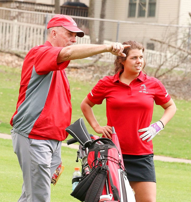 North Scott golf coach Frank Wood gives shot advice to sophomore Jillian Thies during last week's Falcon Invitational at Emies Golf Course.