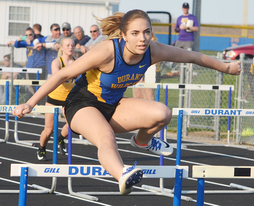 Durant's Addisyn Skinner is shown during the shuttle hurdle relay in Durant April 16. The Cats finished second in the race and then third when they hosted another home meet April 18.