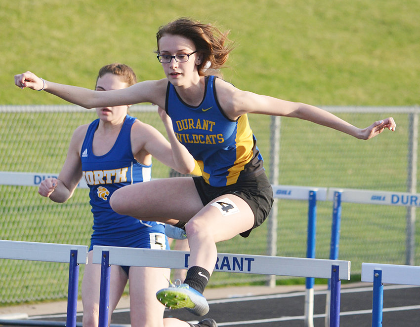 Durant's Savanna Strom competes in the shuttle hurdle relay at a recent home meet.
