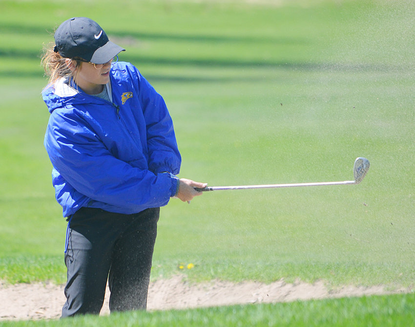 Wilton's Annabel Grings chips out of a bunker on hole No. 7 at Wahkonsa during home tournament action April 26.