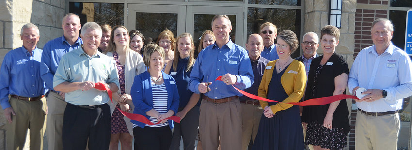After breaking ground in June of last year, staff and board members of the Wilton Bank office of DeWitt Bank & Trust officially opened to the public April 29 in its new location at 618 W. Fifth St. in Wilton. The bank had a big weekend with open houses on April 26 and 27 for both customers and the community, which included a ceremonial raising of the American flag by the Wilton American Legion Post 584 and a ribbon cutting ceremony (pictured above) April 26. DeWitt Bank & Trust President Greg Gannon is shown above (middle) cutting the ribbon, surround by the bank's directors and Wilton Bank staff. As previously reported, the $2.8 million project features 9,270 square feet. For more photos, see page 20.