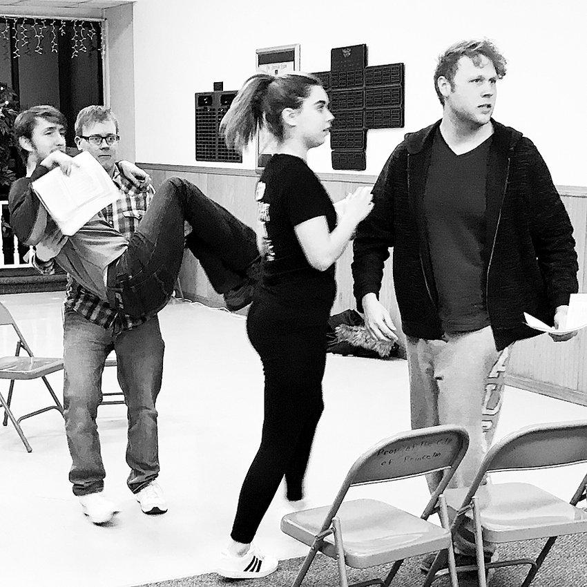 "Joshua Malone, Michael Byrne, Martha Behnke and Justin Tegeler rehearse a scene for Countryside's ""The 39 Steps."""