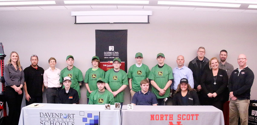 Students from North Scott and Davenport West high schools held a Signing Day ceremony on Thursday, as they committed to welding apprenticeships with area businesses. Pictured are the students and employers who were on hand. Front Row: Blake Linz (West),  Dakota Sweetland (West).  Justin Moeller (North Scott) and Myah Herrington (North Scott).  Back row: Maria Olsen (ALM), Andy Zinn (Davenport West teacher), Mary Pat Tubb (Deere), Jorden Holmes (West), Charlie Kirkley (West), Sam Buckley (West), Gabe Barker (West), Nick Kilker (North Scott), Tom Johnson (Deere), Kevin Toft (ALM), Julie Cotton (Eckhart), Travis Turner (Eckhart), David Linnenbrink (North Scott teacher).