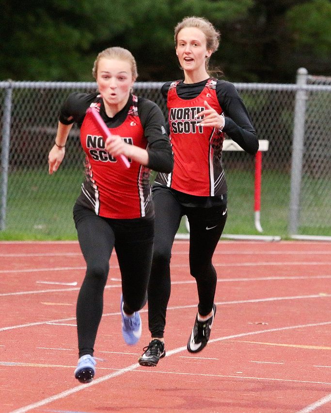 Freshman Savanna Bruck is off and running after taking the baton from senior Avery Rowlands in the 4x100 relay at Thursday's MAC meet. North Scott finished third in the event.