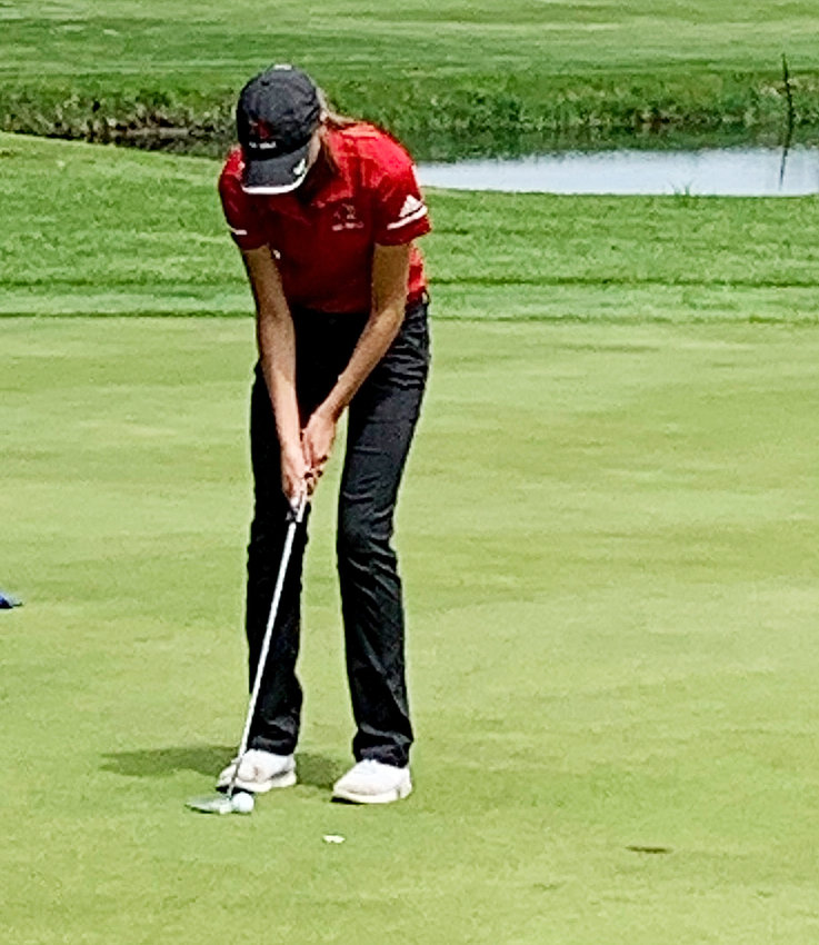 Junior Avery Woods putts out on the final hole at Kewanee Dunes on Monday. She carded a 96, which was good for eighth place.