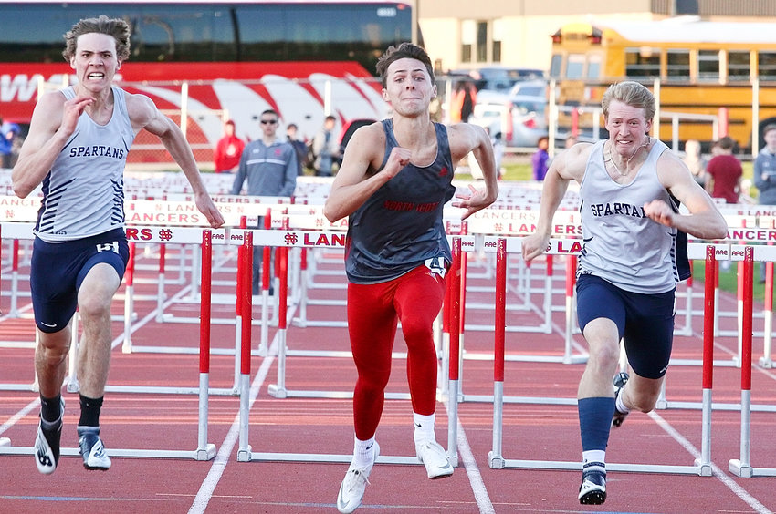 After taking a tumble in the shuttle hurdle relay, Lancer senior Spencer Thomas bounced back and edged Pleasant Valley's Porter Cottrell to win the 110 high hurdles. He will be seeded eighth at the state meet.