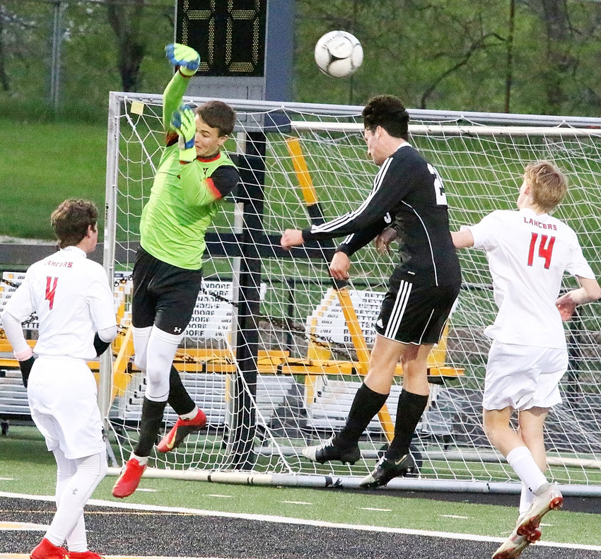 Despite giving up three goals, Lancer keeper Colin Wiersema played well in the 3-0 loss to Bettendorf, making several key saves, like this one.