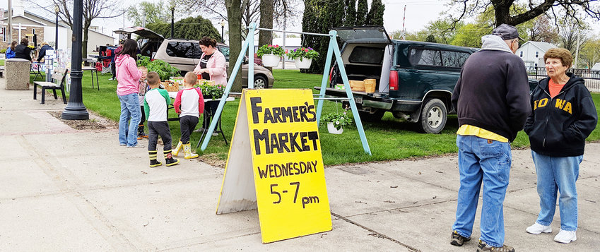 Visitors attend one of the first Durant Farmer's Market days of the season earlier this month.