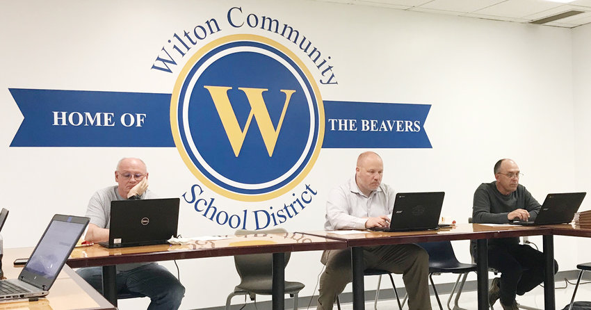 The Wilton school board has shifted where it holds its monthly meetings. They are still held in the Jr./Sr. High media center, but along the south wall instead, where a new mural has been painted. The mural is shown above, with board members Tony Hurd, Rob Metzger and Gary Maurer partaking in the May meeting.