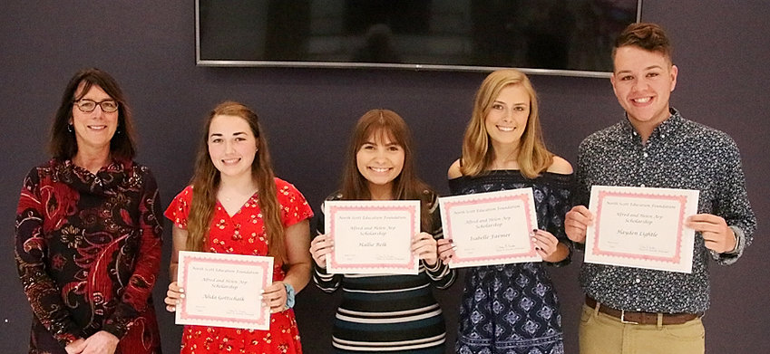 NSEF board member Judi Sarafin (l) presented $6,000 Alfred and Helen Arp Scholarships to Alida Gottschalk, Hallie Belk, Isabelle Farmer and Hayden Lightle.