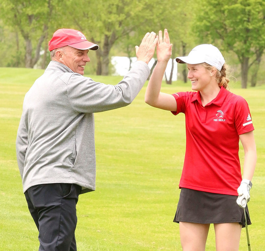 Talk about good coaching. As junior Grace Bjustrom prepared to hit her chip shot onto the 14th green at Tuesday's (May 14) Lancer Invitational, Lancer coach Frank Wood told her to swing easy and let the ball roll into the cup. Bjustrom did exactly that, and then received a high-five from Wood after converting the birdie.