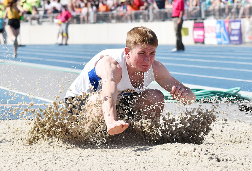 Jake Willkomm of Durant competing in the long jump at state.