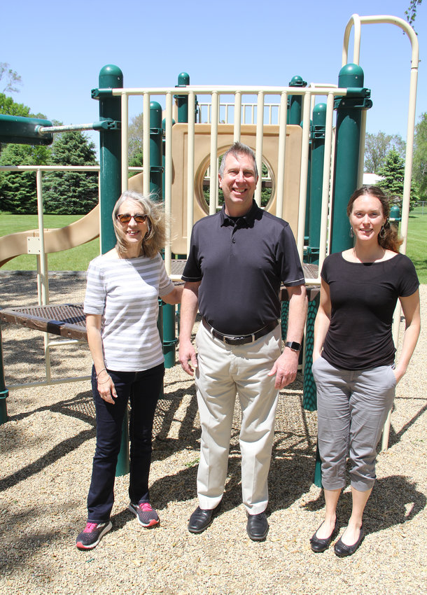 Long Grove council member Nancy Herrin, left, Mayor Michael Limberg and city clerk Rose Guyer pose at the site of the new playground funded by SCRA and Long Grove taxpayers.