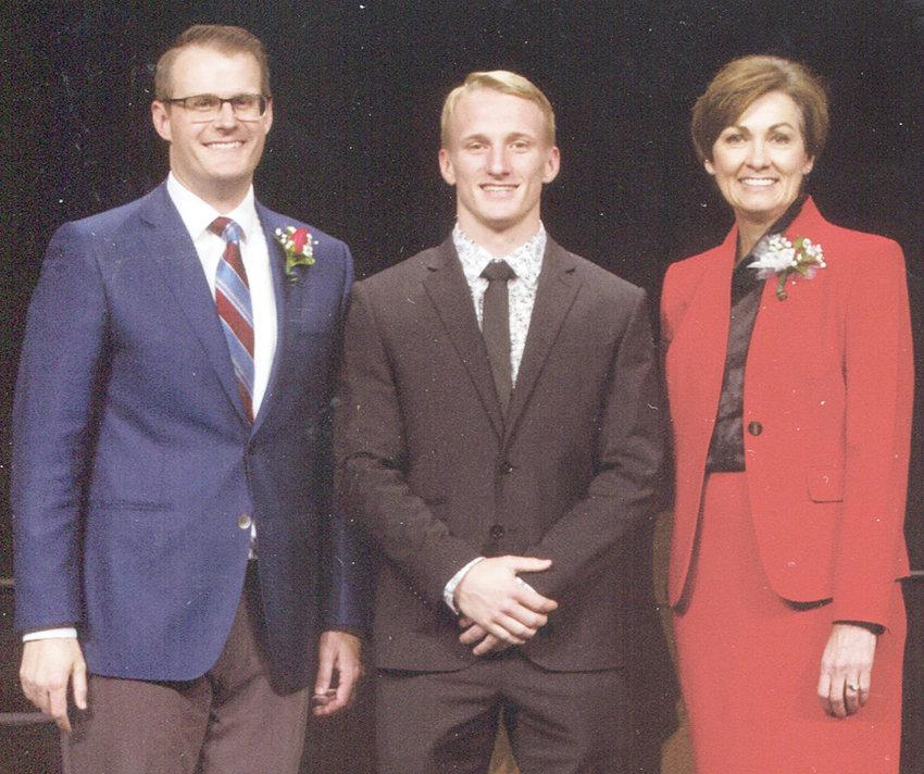 Wilton senior Jerome Mays is shown above pictured with Iowa Lt. Gov. Adam Gregg and Gov. Kim Reynolds.