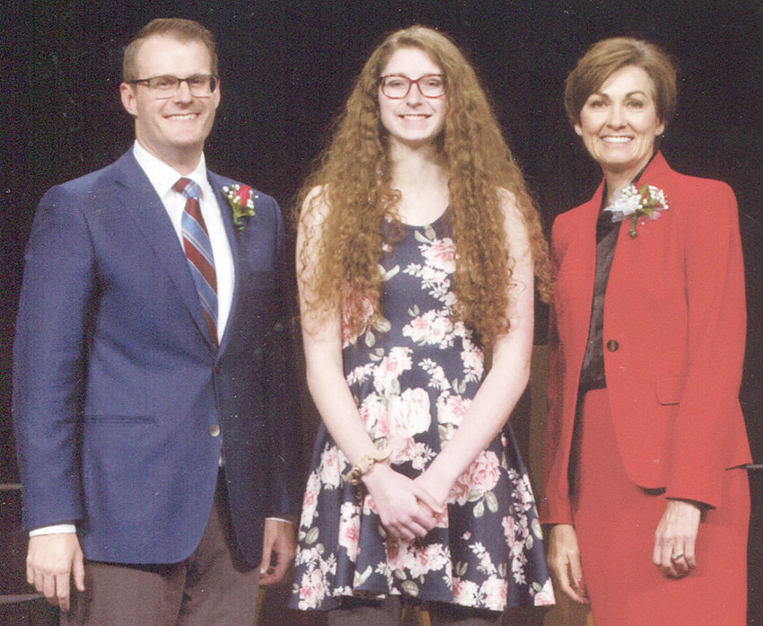 Durant senior Brianna Howe is shown above pictured with Iowa Lt. Gov. Adam Gregg and Gov. Kim Reynolds.