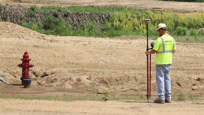 A Valley Construction worker surveys streets in the new Valley View Farms subdivisions near Park View Friday.