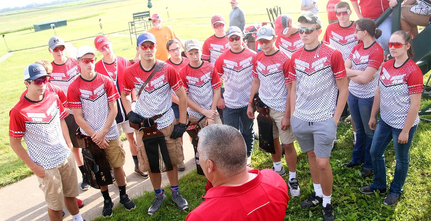 North Scott's trap team was locked and loaded Thursday morning as they listened to coach Eric Long give final instructions before their morning doubles competition.