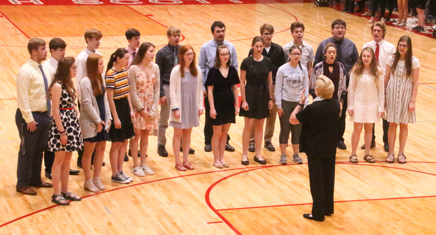 Members of North Scott Singers perform the National Anthem during the Special Runners aud.