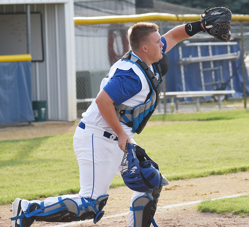Durant catcher Logan Callison makes a catch just in front of home plate against Regina.
