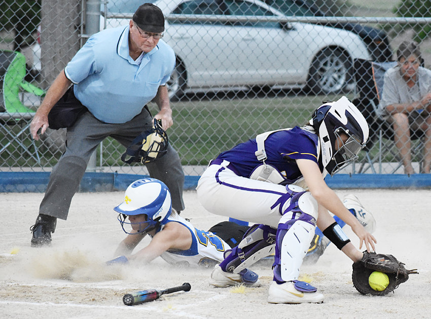 Durant's Ruby Kappeler slides safely into home plate in the win over Keokuk. She leads the team with 25 stolen bases and 25 runs scored this season.