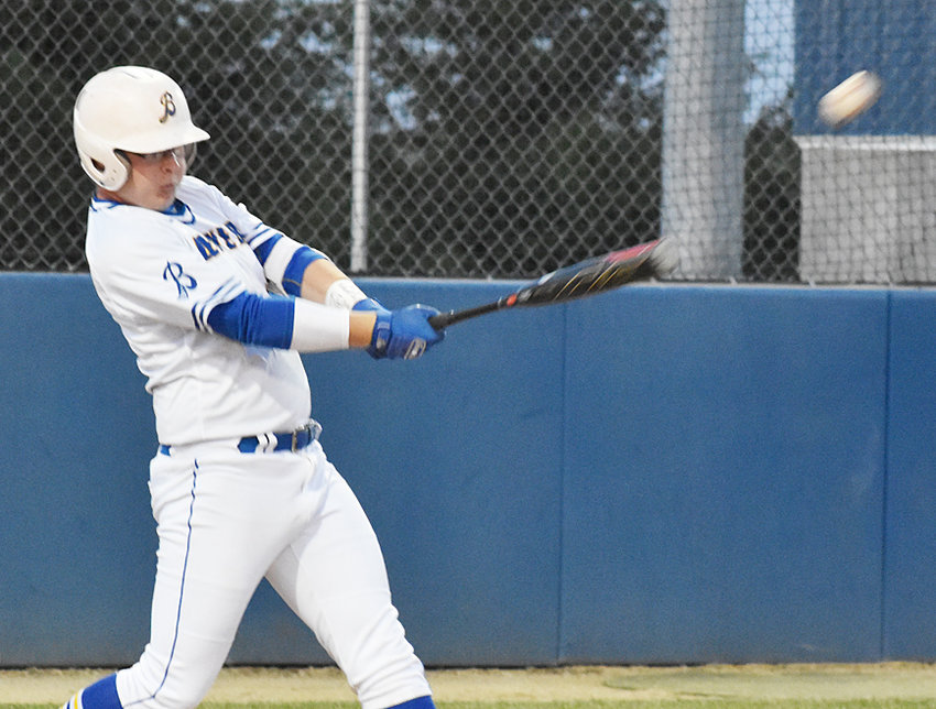 Wilton's Clayton Cooling puts the bat on the ball in home action against Bellevue June 13. The Beavers beat the Comets 2-0.