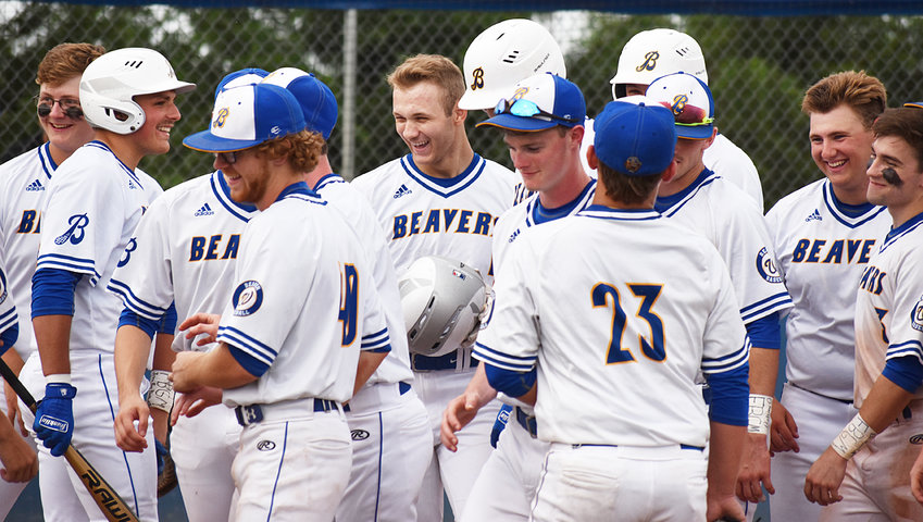 Collin McCrabb (middle) gets mobbed by his teammates after hitting one of three home runs last week. He leads Class 2A with six home runs on the season. He also got back on the mound Monday in North Cedar for the first time since the opening games of the year.