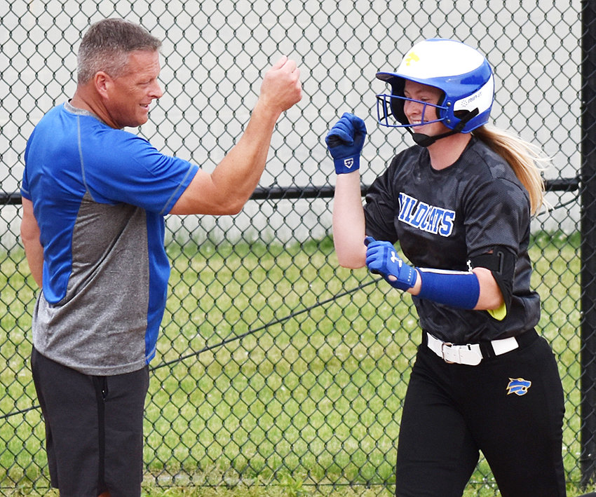 Allie Poston hit four home runs in a doubleheader at Tipton, including three in game two. She's congratulated by Durant coach Kevin Kaalberg.