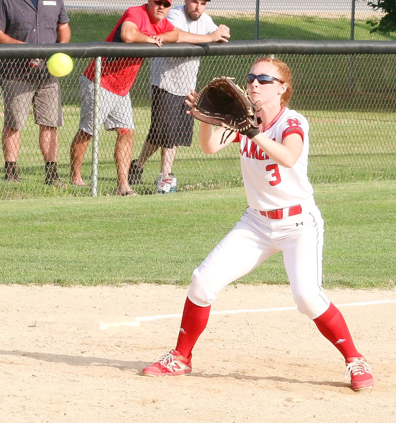 Keeping her eye on the ball, or so it seems, junior Alexis Beadle snags a line drive at third in the 3-2 loss to Muscatine.
