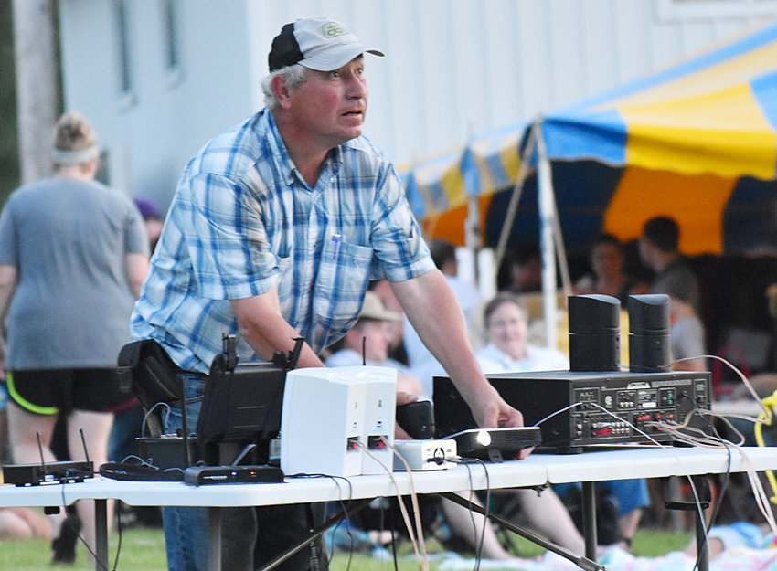 Rod Treimer is shown preparing for the videos he presented during the annual Durant fireworks celebration on the Fourth of July. The videos were shown on a large screen near the concession stand between the football and baseball fields.
