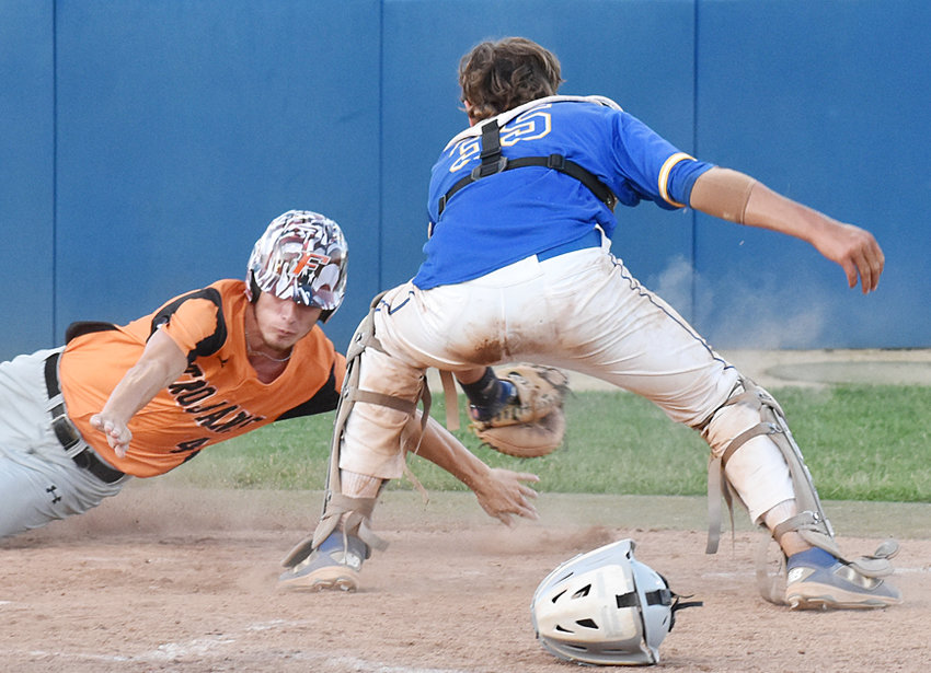 Wilton catcher Brock Hartley tries to put a tag on a Fairfield runner at the plate.
