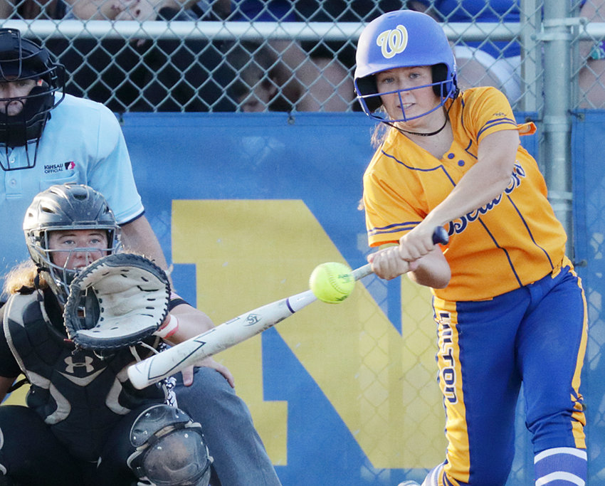 Wilton's Emi Coss is shown putting the bat on the ball in home Regional action against Pekin July 10. The Beavers were defeated 6-3 and ended the season 18-20 overall.