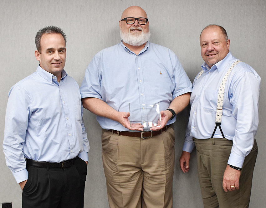 CIPCO awarded by National Safety Council—Pictured above, from left, Dan Burns, CIPCO Vice President, Utility Operations; Rex Butler, CIPCO Manager, Environmental & Safety; and Vago Galounis, National Safety Council Senior Director.