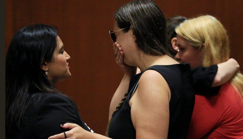 Defense attorney Meenaskshi Brandt, left, comforts Lindsay Andrews as the verdict is read.