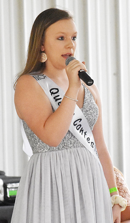 Wilton High School junior to be Becky Imhoff answering on-stage questions during the Muscatine County Fair Queen contest July 17. Imhoff helped the Advocate News with photo coverage of the Cedar and Muscatine County fairs. Fair coverage coming soon.