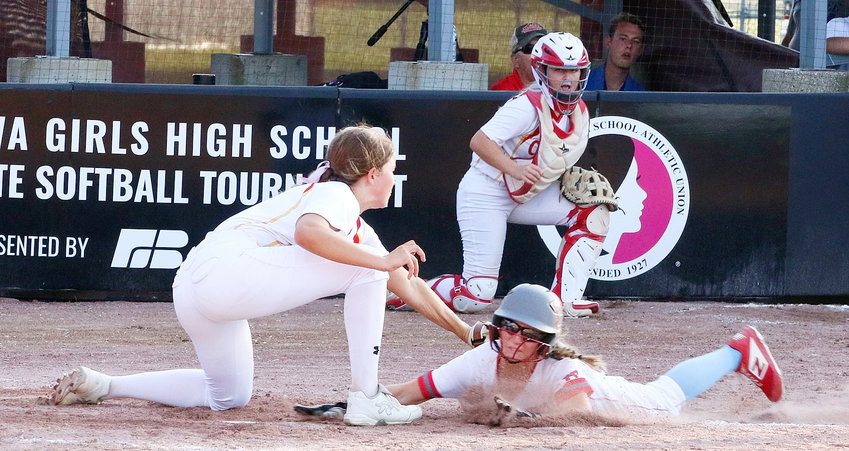 After two miraculous comebacks and a bang-bang play at the plate went in their favor, the worm turned for North Scott's softball team when Carlisle pitcher Molly Hoekstra tagged out Sam Lee as the Lancer junior tried to score the tying run on a sixth-inning wild pitch.