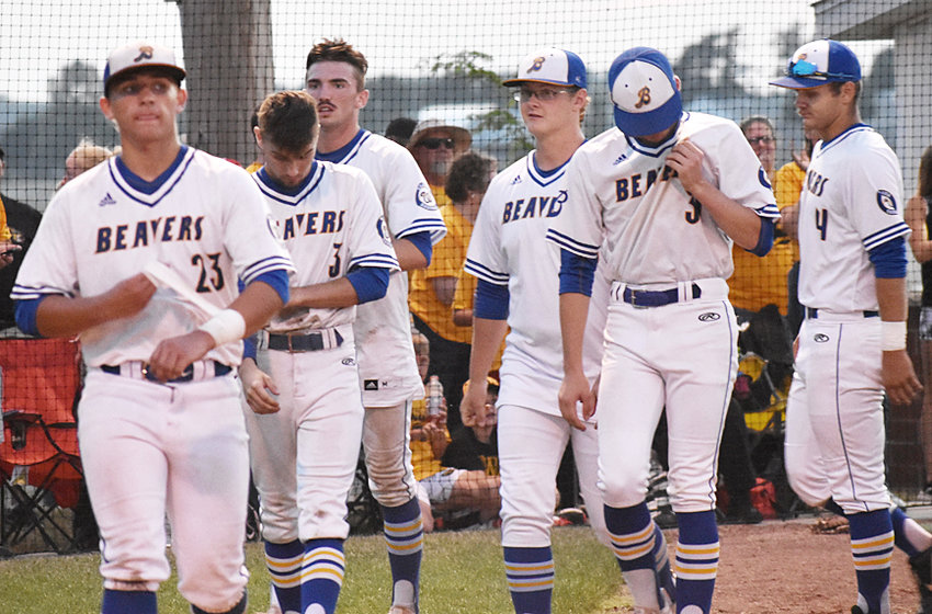 Members of the Wilton baseball team react moments after shaking hands with Central Lee players after a 14-0 loss in five innings in a Class 2A Substate game in Washington July 23.
