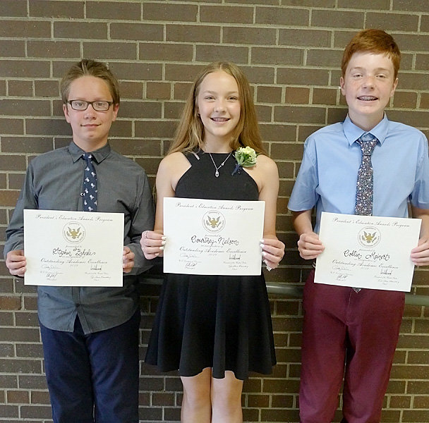 These students at John Glenn Elementary in Donahue received exceptional marks in fourth, fifth and sixth grade and were presented the Academic Excellence Award. From left: Stephen Behnke, Courtney Nelson and Collin Meinert.