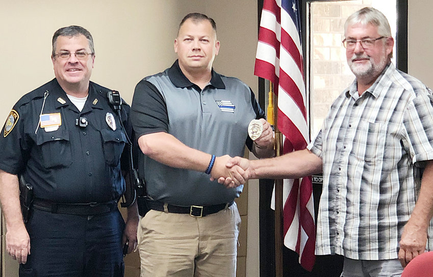 The Durant Police Department swore in its newest officer July 23. Brian Utter is shown above (center) with Chief Orville Randolph (left) and Mayor Scott Spengler (right). Utter had been on city council for 7 1/2 years before resigning the day before being offered a full-time position with Durant PD.