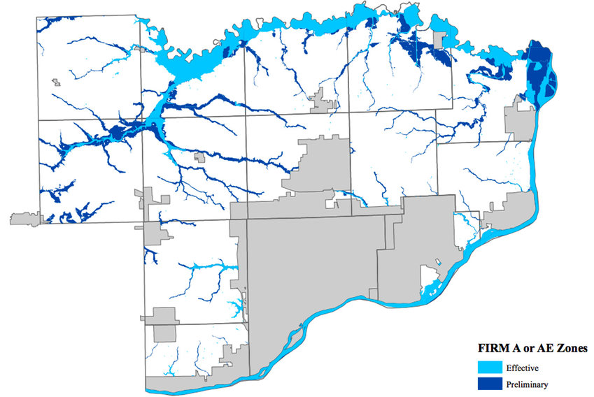 The darkest areas denote proposed rural county expansions to the Scott County flood plain, mostly along Mud Creek, Wapsi River and Princeton backwaters of the Mississippi River.