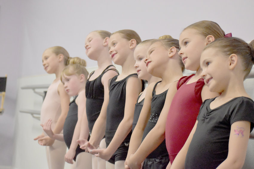 From left: Aislyn Seals, Elizabeth Recker, Claire Welsh, Emily Jensen, Ashlyn Johnson, Elena Robinson, Hannah Howell, and Lillian Zink practice right before the audition.