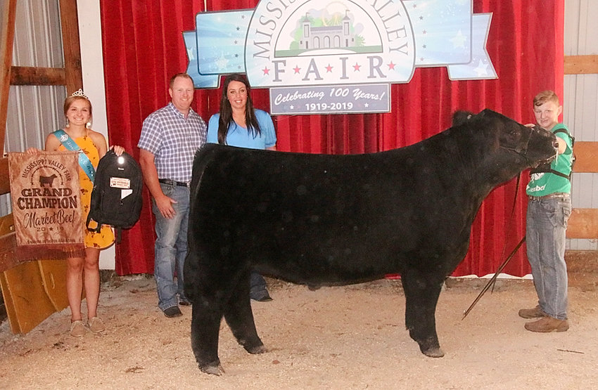 Dawson Book showed the Grand Champion Market Steer that was also the Champion Crossbred. He's pictured with Mississippi Valley Fair Queen Chloe Engelbrecht and judges Cori and Ryan Malone.