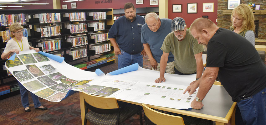 Wilton Mayor Bob Barrett and members of the city council toured several Wilton facilities Aug. 12 prior to their evening meeting. The first stop was the Wilton Public Library & Community Center, where they were shown plans for a future outdoor reading garden at the library. Above, librarian Sharon Bowers (left) shows members plans of what the garden could look like, along with suggested flowers and plants to be used. (From left) Steve Owens, Mayor Barrett, Keith Stanley, Ted Marolf and Sheryl Lenker are shown.
