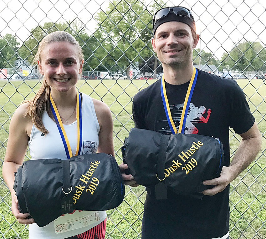 2019 Durant Dusk Hustle winners—Rick Pahl (right) repeated as Durant Dusk Hustle champion Aug. 9, completing the annual 5K race in 16:39. He's won the last three Dusk Hustles. Madison Howe (left) was the top female finisher in a time of 22:43.