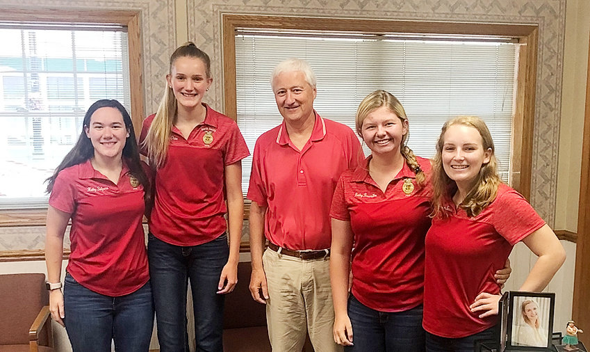 Members of the North Scott FFA communications team reached out to community members over the summer, and made a stop at The North Scott Press to visit with editor Scott Campbell. From left: Haley Salyars, Anna Otte, Campbell, Hailey Rossmiller, and Ceandra Staub.